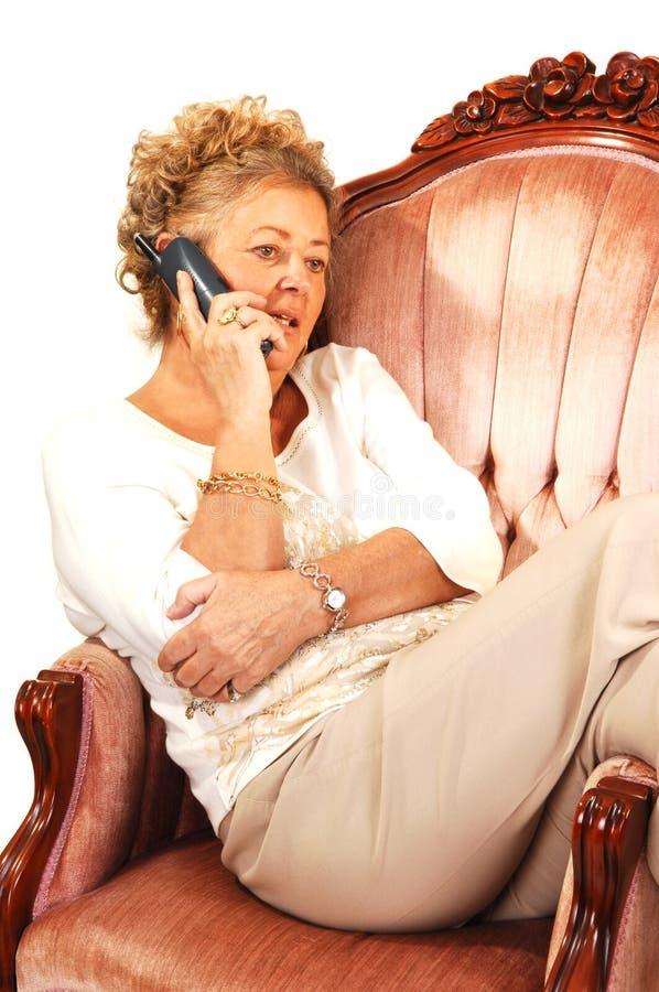 电话前辈妇女 免版税图库摄影