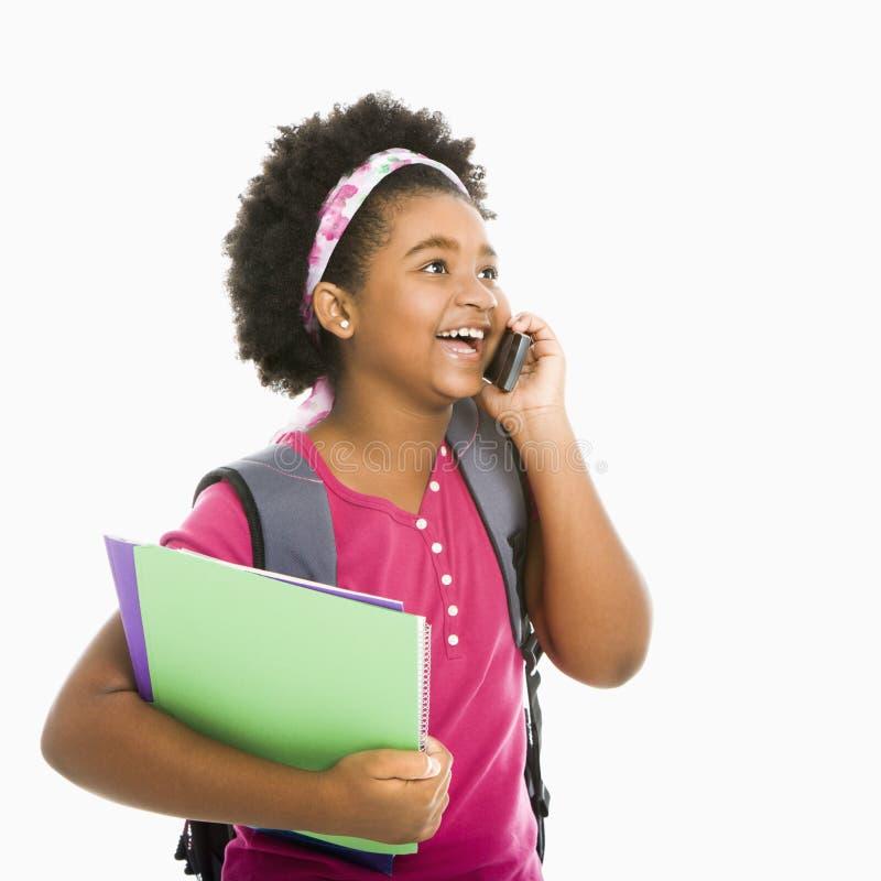 电话女小学生 免版税库存照片