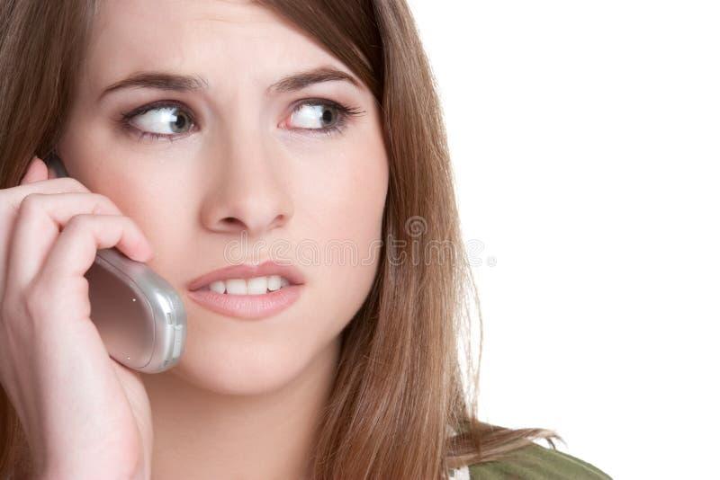 电话妇女担心 免版税库存照片