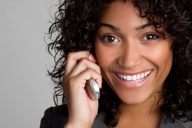 电话微笑的妇女 库存图片