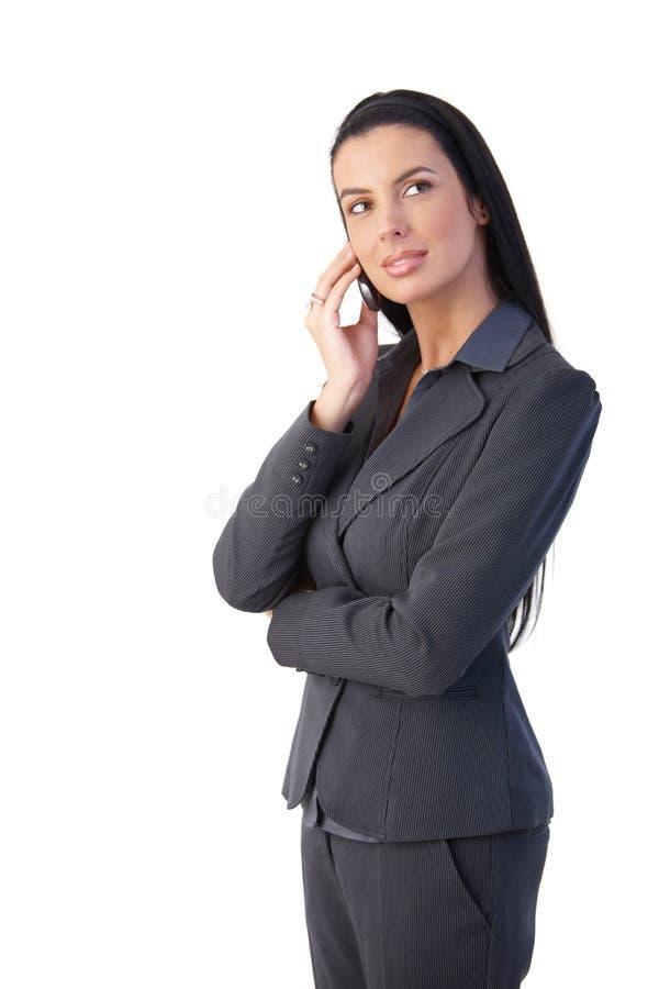 电话的可爱的女实业家 免版税库存图片