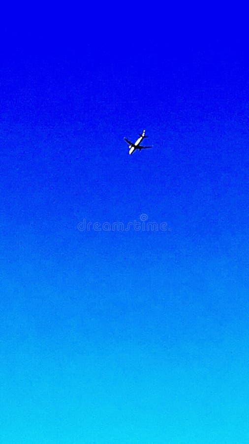 电话的天空和飞机背景 免版税库存照片