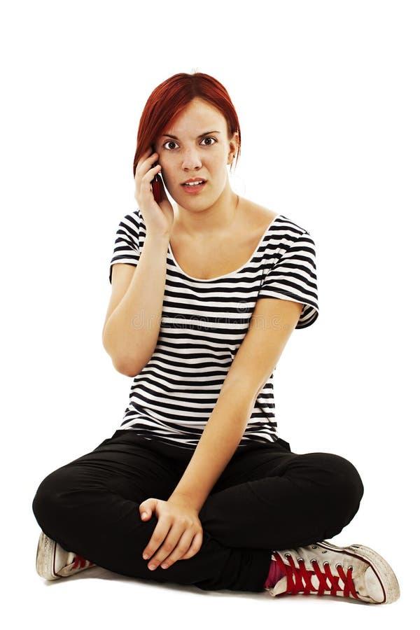电话的沮丧的妇女 免版税库存照片