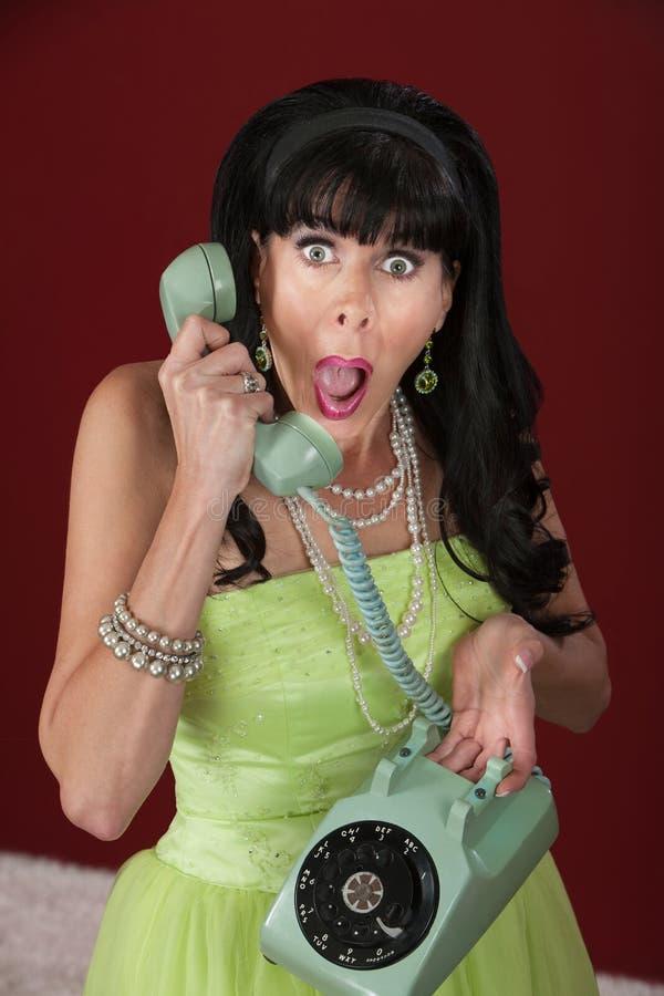 电话的震惊妇女 库存照片