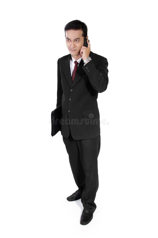 电话的年轻企业家 库存照片