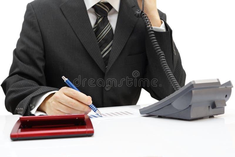 电话的财政顾问 库存照片