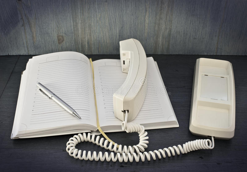 电话,笔,笔记本 库存照片