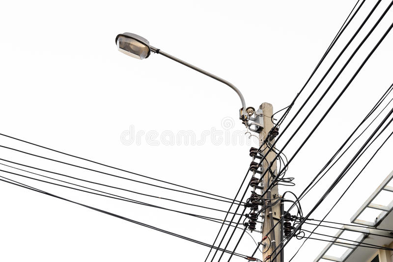电pos,与街灯的缆绳线 免版税库存图片