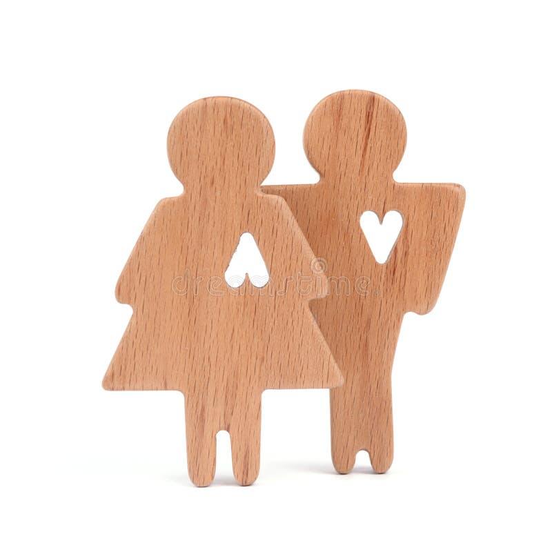 男人、妇女和心脏剪影删去了在白色背景的形状里面 夫妇愉快的爱 男性和女性,不同 库存图片