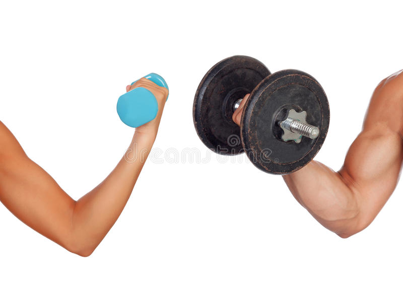 男人和妇女举的重量的胳膊 免版税库存图片