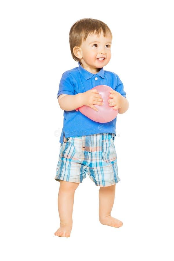 男婴全长画象,与气球的愉快的孩子在白色,一岁的孩子 库存图片
