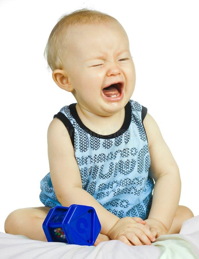 男婴哭泣的翻倒非常 库存照片