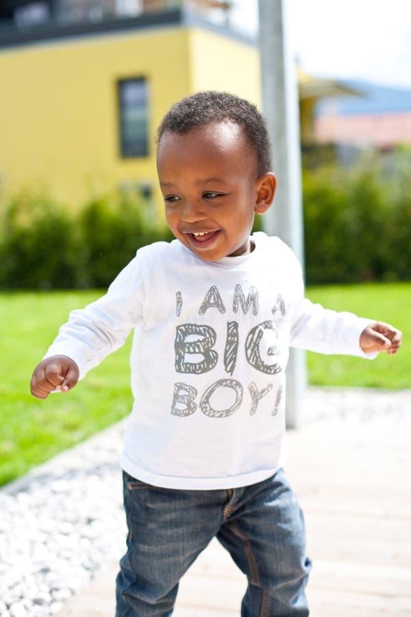 男婴庭院年轻人 库存照片