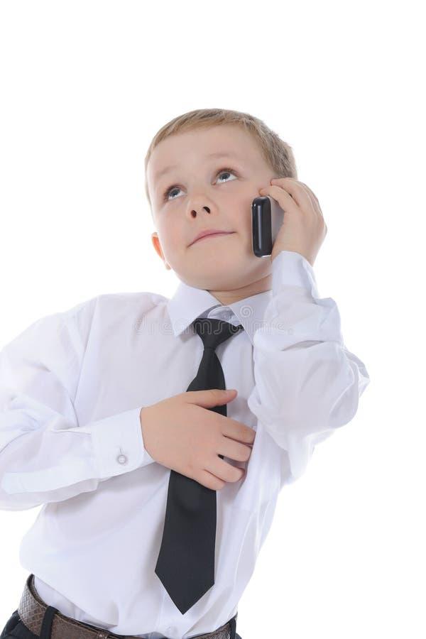 男孩一点电话联系 库存图片