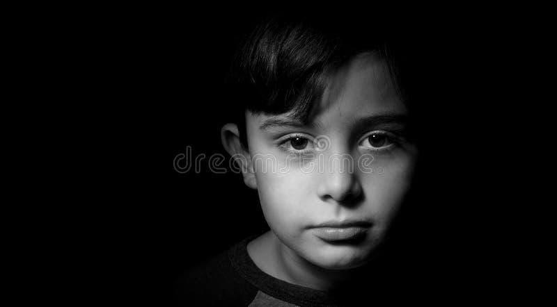 年轻男孩低调画象  库存图片