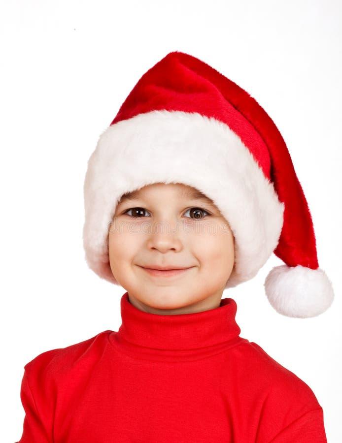 男孩克劳斯帽子圣诞老人 免版税库存照片