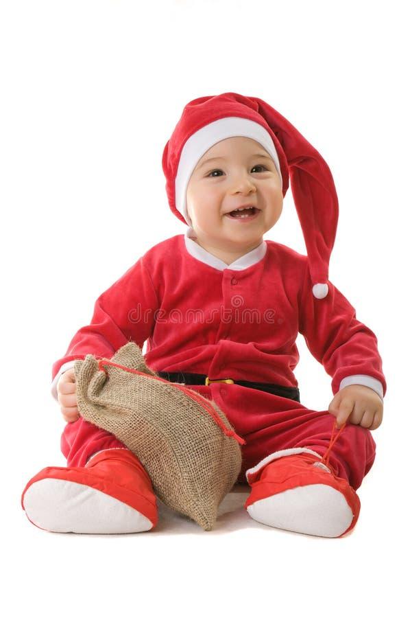 男孩克劳斯穿戴了小的圣诞老人 免版税库存图片