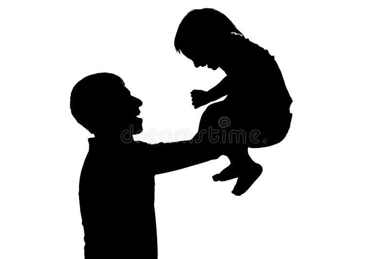 男孩剪影在父亲在白色的` s手上隔绝了背景 库存照片