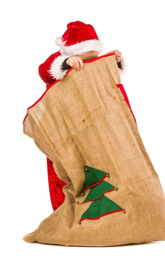 男孩和圣诞节大袋 免版税图库摄影
