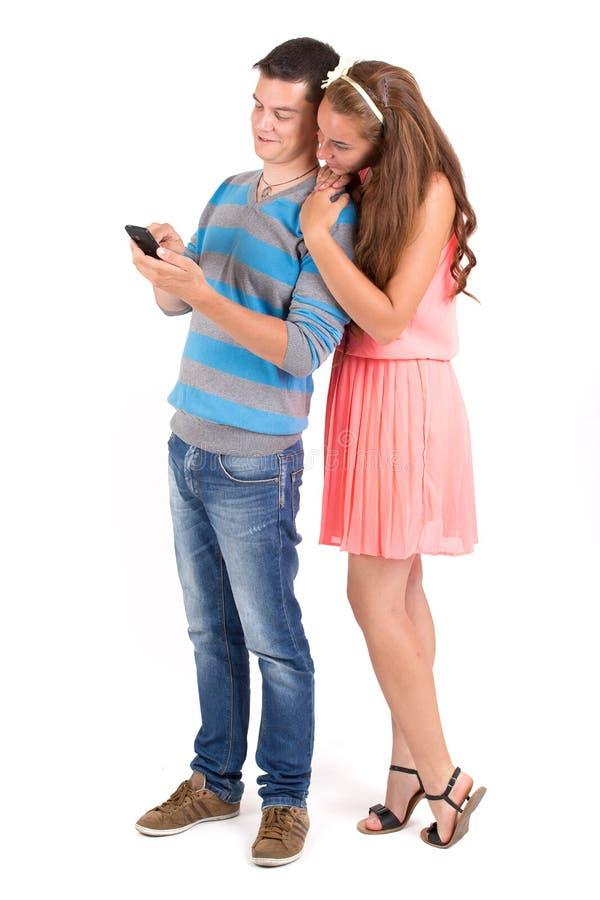 年轻男孩和女孩有智能手机的 免版税图库摄影