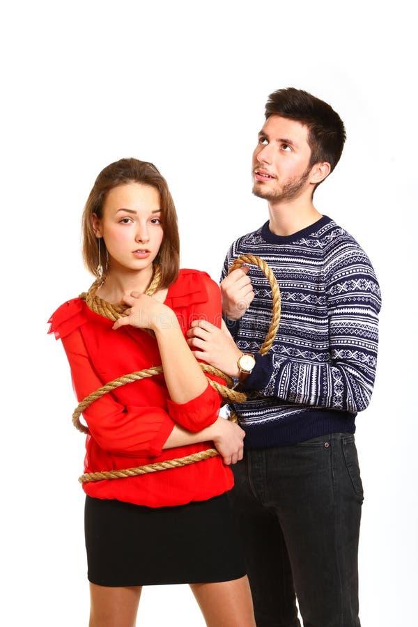 男孩和有在白色查出的绳索的附加的女孩纵向  免版税图库摄影
