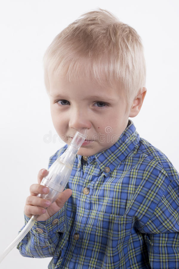 男孩和鼻吸气器 图库摄影
