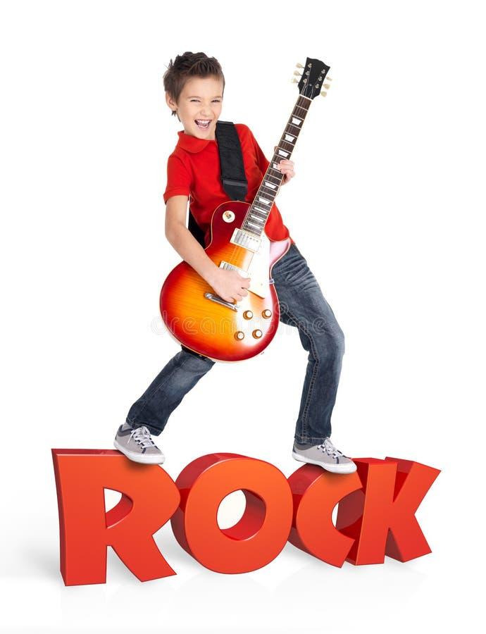 男孩在有3d文本的电吉他使用 免版税图库摄影