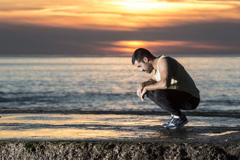 男孩在阳光的焦点 库存照片