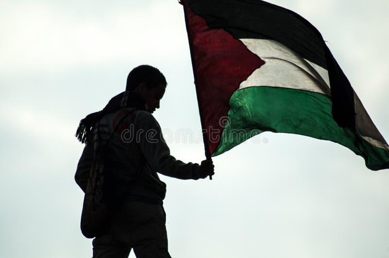 男孩在阿拉伯革命 免版税库存照片