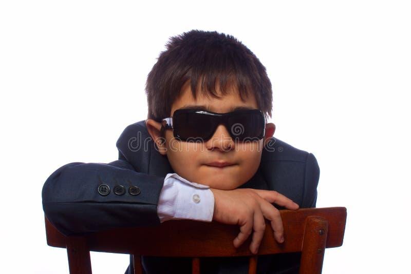 男孩墨镜头发的星期日 库存图片