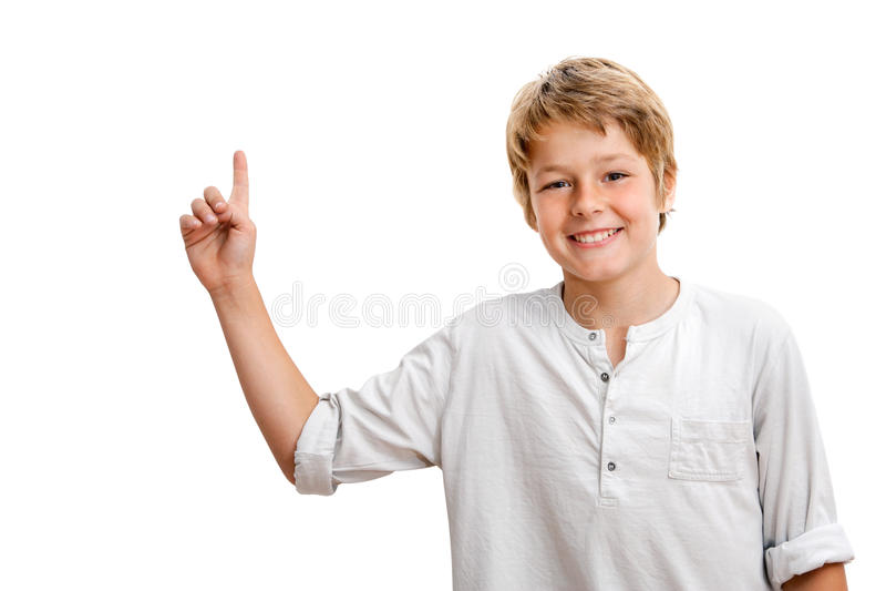 男孩复制英俊的指向的空间 免版税库存照片
