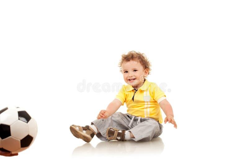 男孩对等待的一点作用 免版税库存照片