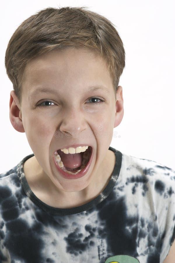 男孩尖叫的年轻人 免版税库存图片