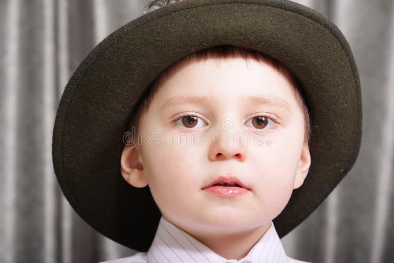 男孩帽子一点 图库摄影