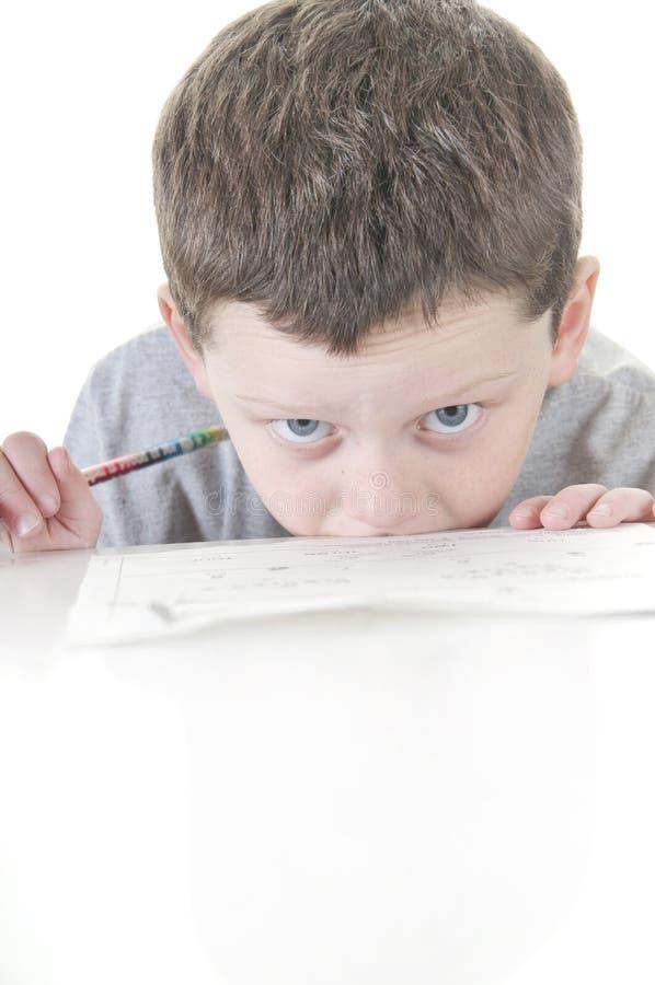 男孩强调的工作年轻人 库存图片