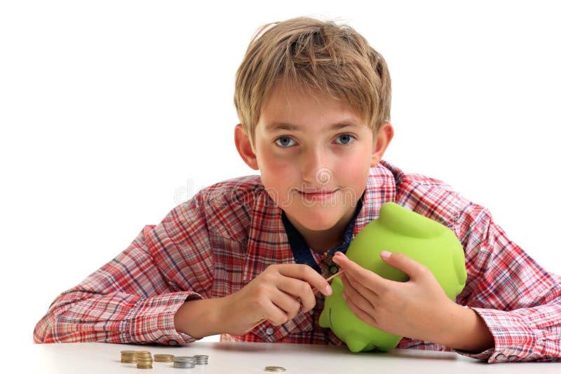 男孩得到金钱 图库摄影
