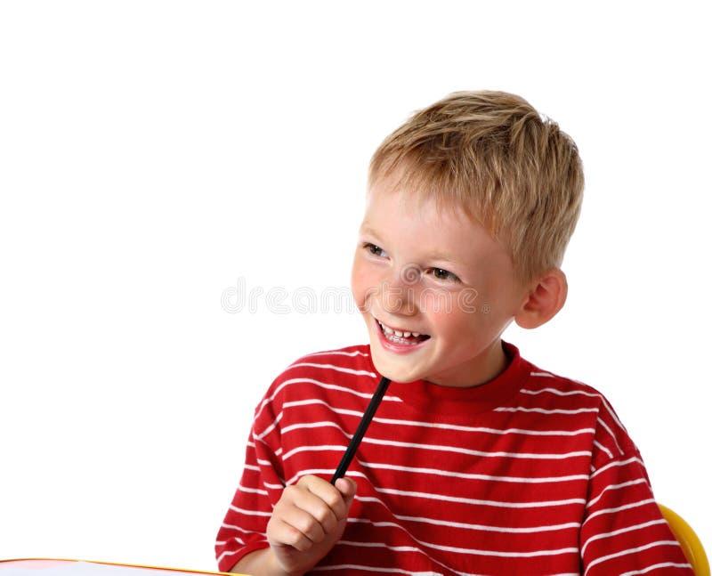 男孩愉快的小的铅笔 库存图片
