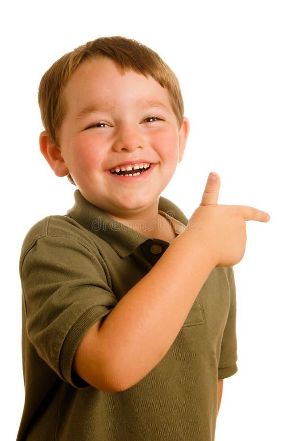 男孩指向年轻人的儿童方向 免版税库存图片