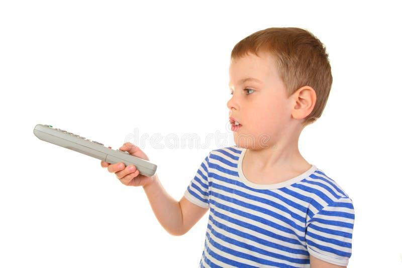 男孩控制遥控 免版税库存图片