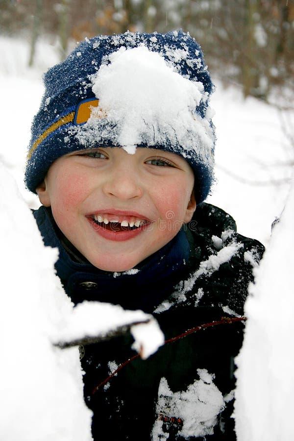 男孩日愉快的雪 免版税库存图片