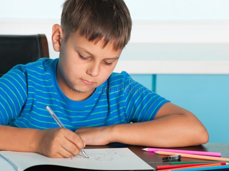 男孩服务台图画 免版税库存图片