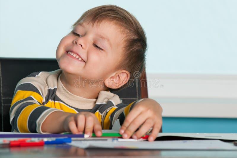 男孩服务台成功的一点 免版税图库摄影