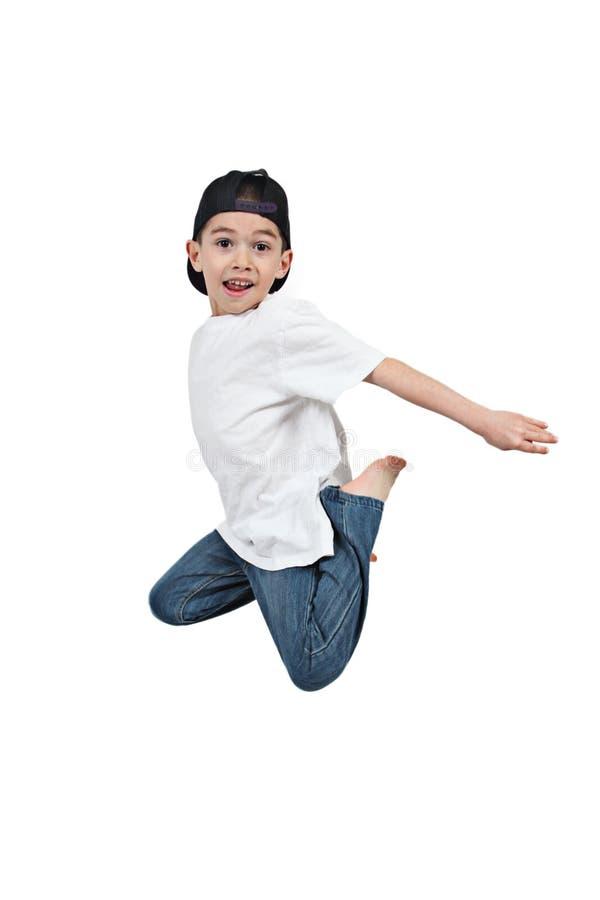 男孩查出的跳的白色 免版税库存照片