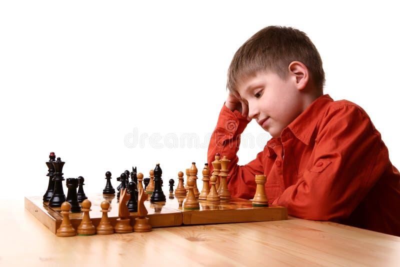 男孩棋使用的一点 免版税库存照片