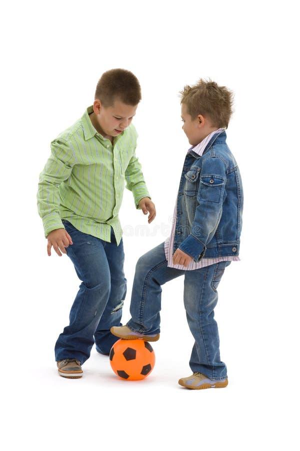 男孩橄榄球使用 免版税图库摄影