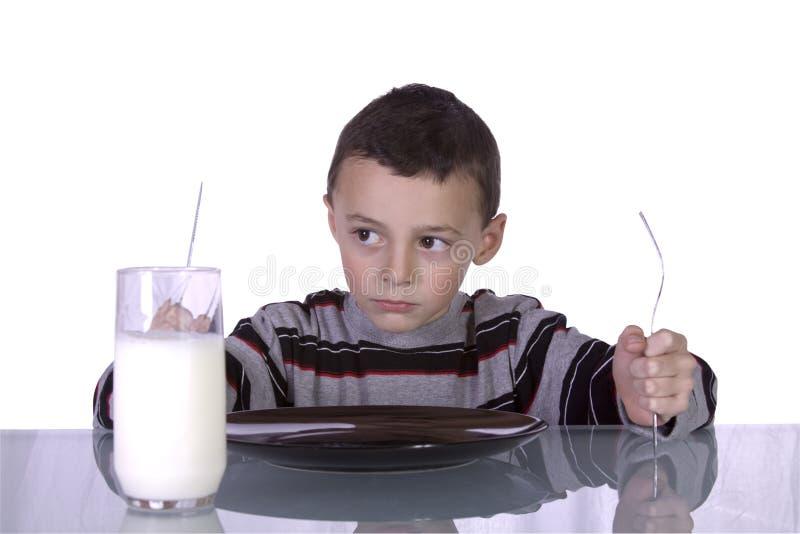 男孩正餐等待的一点 免版税库存照片