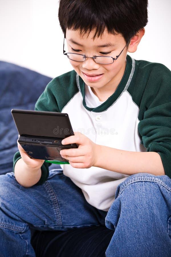 男孩比赛使用 免版税库存图片