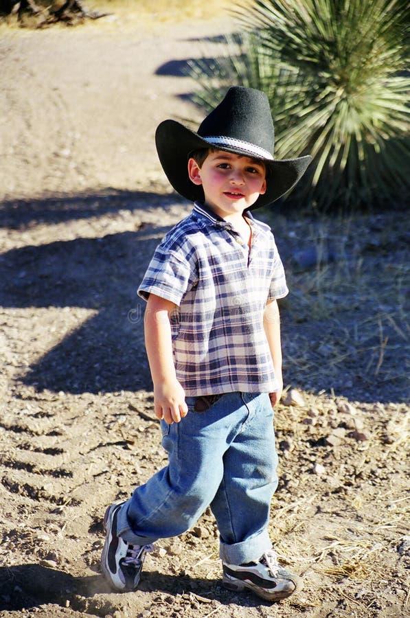 男孩牛仔帽佩带的一点 图库摄影