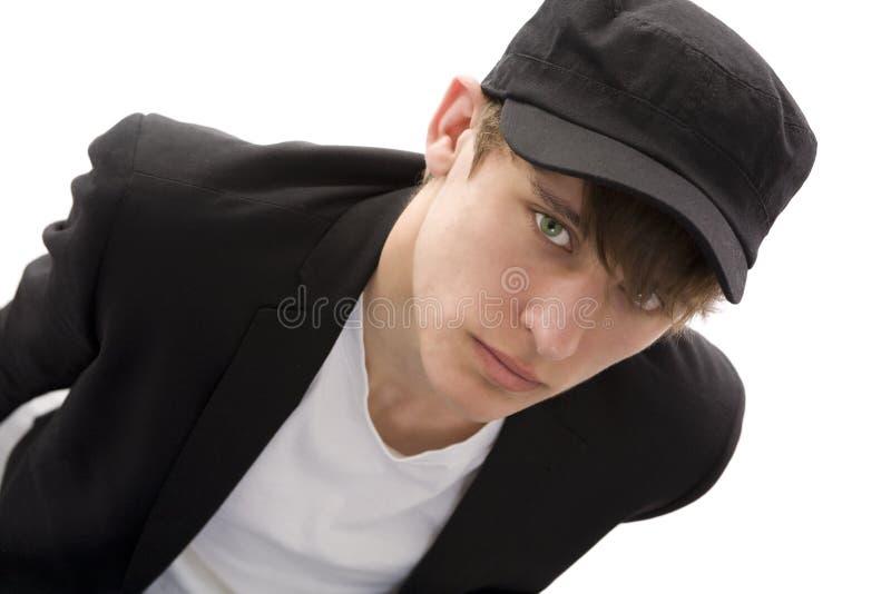 男孩盖帽 库存图片