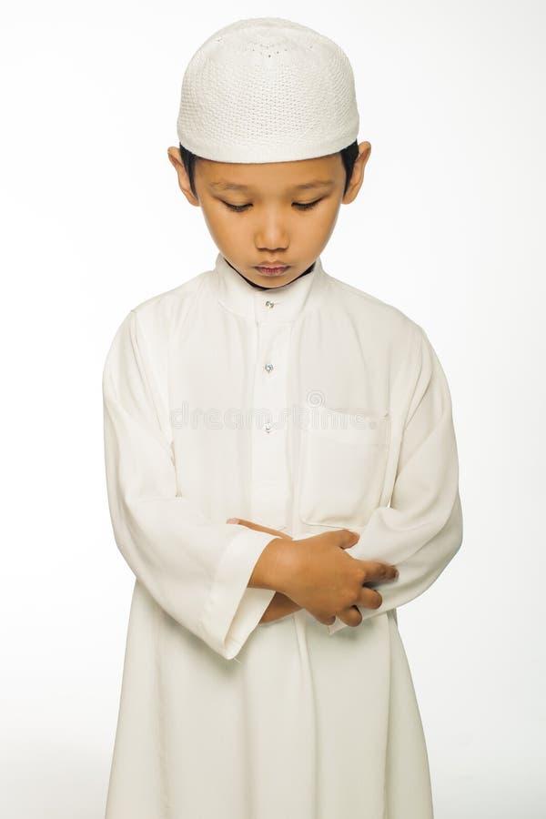 男孩祈祷 图库摄影